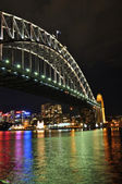 Sydney Central Business District lights reflected under Sydney Harbour Bridge — Stock Photo
