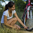 Stock Photo: Pumping the bicycle wheel