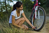 Pumping the bicycle wheel — Stock Photo