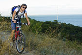 Riding a bicycle along the Black Sea — Stock Photo
