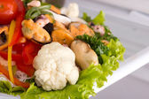 Salad of seafood and vegetables — Stock Photo