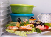Seafood sandwich and canapés in the fridge — Stock Photo