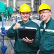 Industrial workers with notebook, teamwork — Stock Photo #10069345