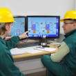 Industrial workers in control room — Stock Photo #10149956