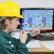 Industrial worker in control room — Stock Photo