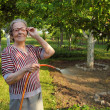 Senior Woman watering in Garden — Stock Photo