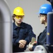 Two workers talking in a factory — Stock Photo #9532045