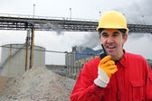 Industrial Worker, controls work in a factory — Stockfoto