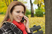 Woman talking on a mobile phone — Foto Stock