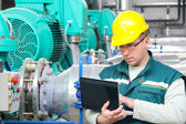 Industrial worker with notebook — Stock Photo