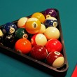 Shot of pool table and balls in triangle. — Stock Photo #9502070