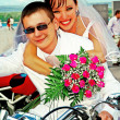 Stock Photo: Bridegroom and bride on motorcycle