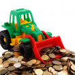 Gree bulldozer raked pile of coins — Stock Photo