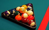 Shot of pool table and balls in triangle. — Stock Photo