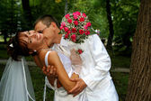Groom kissing bride — Stock Photo