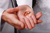 Wedding rings on hands — Stock Photo