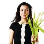 Happy woman holding flowers — Stock Photo