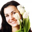 Happy woman holding flowers — Stock Photo