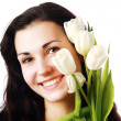 Stock Photo: Happy woman holding flowers