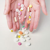 Woman's hands with different meds — Stock Photo
