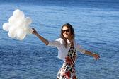 Happy young woman enjoying summer vacation — Stock Photo