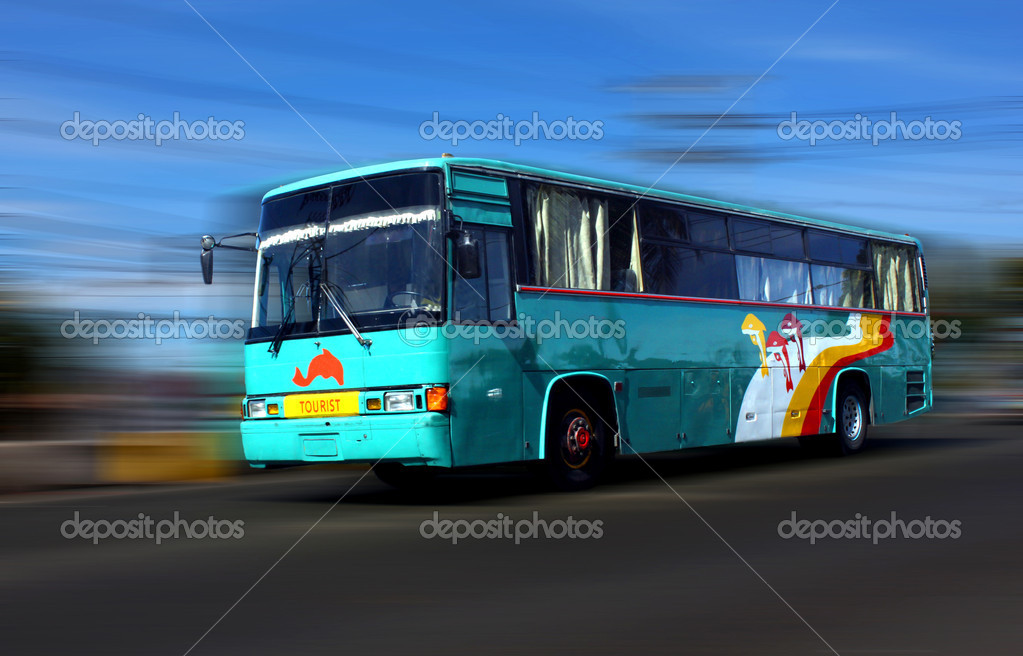 Tourist bus in high speed along the hi-way  Stock Photo #9560344