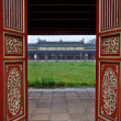 Red Wooden Doors and Temple, Hue Citadel — Stock Photo #9419970