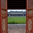 Stock Photo: Red Wooden Doors and Temple, Hue Citadel