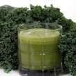 Kale and juice — Stock Photo