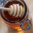 Stir stick in Honey Jar — Stock Photo