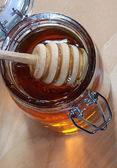 Stir stick in Honey Jar — Stok fotoğraf