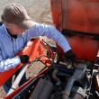 Removing radiator cap on tractor — Stock Photo