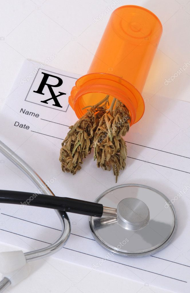 Cannabis bud sitting on a prescription pad, near a stethoscope — Stock Photo #9496669