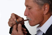 Man smoking marijuana pipe — ストック写真