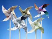 Money toy windmills — Stock Photo