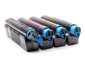 Four color laser printer toner cartridges — Stock Photo
