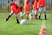Boy on the sports field — Stock Photo