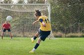 Women kicking ball — Stock Photo