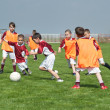 Children playing soccer — Stock Photo