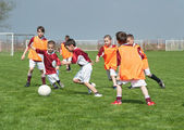 Children playing soccer — Stock Photo