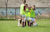 Happy children on the soccer field — Stock Photo
