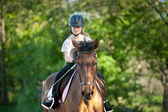 Girl jockey on horse — Stock Photo