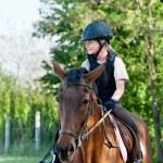 Girl riding a horse — Stock Photo #10470787