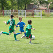 Children playing soccer — Stockfoto #10724969