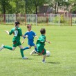 Foto de Stock  : Children playing soccer