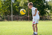Child playing soccer ball — Stock Photo