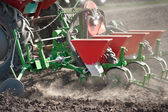 Tractor and seeder — Stockfoto