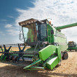 Stock Photo: Combine harvesting soybeans