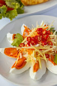Boiled salted eggs with spicy toppings — Stock Photo