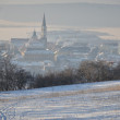 View from snowy hill to small town early morning — Stock Photo #9475020